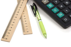 Calculator pen ruler. Calculator with pen and two ruler isolated on white Royalty Free Stock Photography