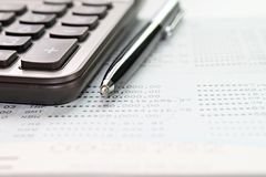 Calculator and pen on savings account passbook or financial statements royalty free stock photo
