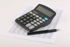 Calculator And Pen On Sheet Royalty Free Stock Photos