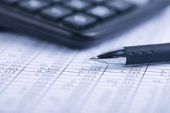 Calculator And Pen On Sheet Stock Photos