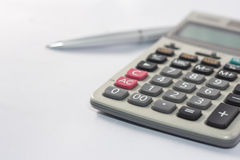 Calculator and pen silver for use in the classroom Royalty Free Stock Photography