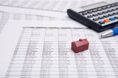 Calculator, pen and  small house Stock Images
