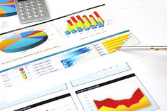 Calculator, pen and stock charts, concept. Finance charts and graphs, finance investment business concept Stock Photo