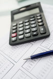 Calculator and pen on the table Stock Photography