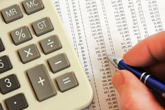 Calculator, pen and a table with figures Royalty Free Stock Photo