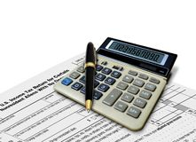 Calculator and Pen on Tax Form Stock Images
