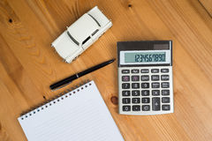 Calculator, a pen and a toy car Stock Photos