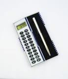 Calculator and pen. Xmas present ? Royalty Free Stock Photos