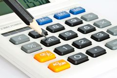 Calculator and pencil Royalty Free Stock Image