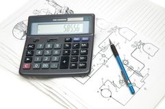Calculator and pencil. Over the  engineering drawings Stock Photos
