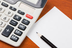 Calculator,pencil and blank notepaper Royalty Free Stock Photos