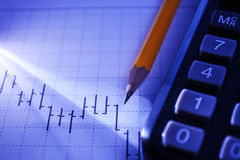 Calculator and pencil on a business graph Stock Photo