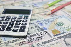 Calculator and pencil on dollar bank note money Royalty Free Stock Photography
