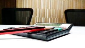 Calculator & pencil in classroom Royalty Free Stock Photo
