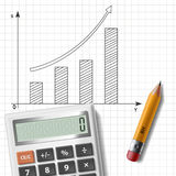 Calculator, pencil and graph. On notebook sheet Royalty Free Stock Photo