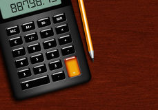 Calculator with pencil lying on wooden desk Stock Images