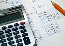 Calculator Pencil Math. A calculator with pencil on math textbook Stock Image