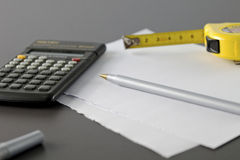 Calculator pencil and meter tape Stock Photos