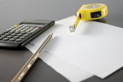 Calculator pencil and meter tape measure Royalty Free Stock Images