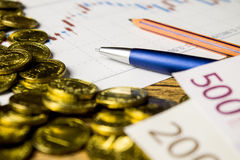 Calculator,pencil and money on graffica the Dow Jones. On forex market Stock Image