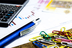 Calculator,pencil and money on graffica the Dow Jones. On forex market Royalty Free Stock Photo