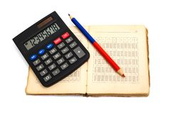 Calculator, pencil and old book Royalty Free Stock Images
