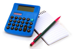 Calculator and Pencil over Notepad. Calculator and pencil pen on a spiral bound notepad ready for taking notes over white Royalty Free Stock Photography