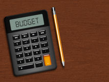 Calculator with pencil over wooden desk Stock Images