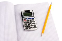 Calculator with pencil on squared paper Royalty Free Stock Images