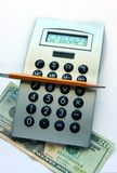 Calculator, pencil and twenty dollars bill stock photography