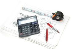 Calculator and pencils over th. E  engineering drawings Royalty Free Stock Photos