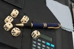 Calculator, Pens, Dice And Financial Concept Royalty Free Stock Photos
