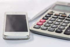 Calculator and phone to use to communicate Stock Images