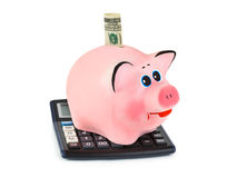 Calculator and piggy bank Royalty Free Stock Photo