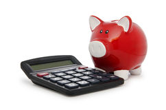 Calculator and piggy bank Stock Image