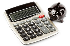 Calculator and piggy bank Royalty Free Stock Images