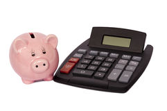 Calculator With Piggy Bank. Pink piggy bank with digital calculator.  Isolated on white.  Studio shot Royalty Free Stock Photography