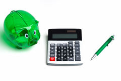 calculator with piggy bank Stock Photo