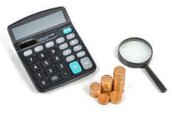 Calculator and piggy bank with coins Royalty Free Stock Photography