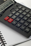 Calculator and Plain Paper Book Royalty Free Stock Image