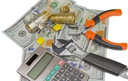 Calculator and plumber tools and banknotes as background Stock Photography