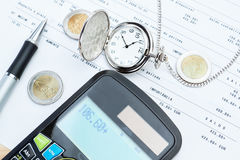 Calculator, pocket watches, money. Stock Image