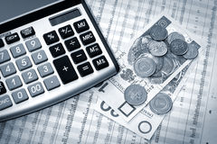Calculator, polish money and newspaper Royalty Free Stock Image