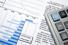 Calculator and printed financial report. Royalty Free Stock Image