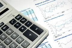 Calculator and printed report. Calculator and printed report with diagramms and graphs Stock Photography