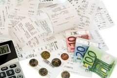 Calculator, receipts, bills. Calculator, receipts and money symbol photo for savings, purchasing power and inflation Stock Image