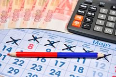 Calculator, red and blue pencil and banknotes of five thousand r Royalty Free Stock Photo