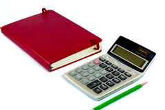 Calculator and red book Royalty Free Stock Photo