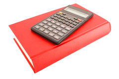 Calculator and red book Royalty Free Stock Photography