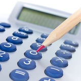 Calculator and red pen Stock Image